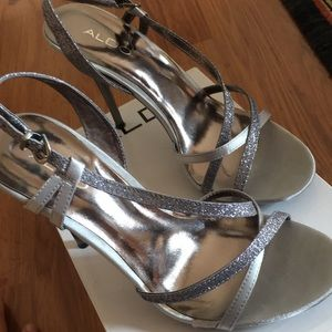 Aldo Shoes - Silver heels with straps.